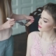 Stylist Does Makeup of the Model. the Girl in a Cocktail Dress Is Getting Ready for the Celebration - VideoHive Item for Sale