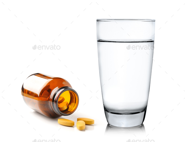Pills from bottle and Glass of water isolated on white backgroun - Stock Photo - Images