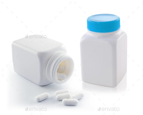 white bottle with pills isolated on white - Stock Photo - Images