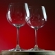 Two Empty Glasses for Wine on a Red Background Rotates on Wooden Platform - VideoHive Item for Sale