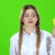 Schoolgirl in White Blouse with a Credit Card Is Sad Green Screen - VideoHive Item for Sale