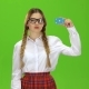 Schoolgirl in Glasses Shows a Finger Down . Green Screen - VideoHive Item for Sale