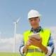 Engineer Using Digital Tablet on Wind Turbine Farm - VideoHive Item for Sale