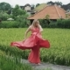 Slow Shooting Young Dancer Performs a Passionate Emotional Dance in the Rice Field, with a View of - VideoHive Item for Sale
