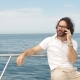 Young Bearded Man Talking on Smartphone on a Luxury Yacht - VideoHive Item for Sale