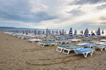 Sunbeds and umbrellas on the calabrian beach - PhotoDune Item for Sale