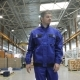 Engineer in in Blue Uniform Is Walking Through Factory - VideoHive Item for Sale