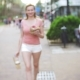 Girl Leaves the Pastry Shop with Croissants a Donut and Coffee for a Company of Friends - VideoHive Item for Sale