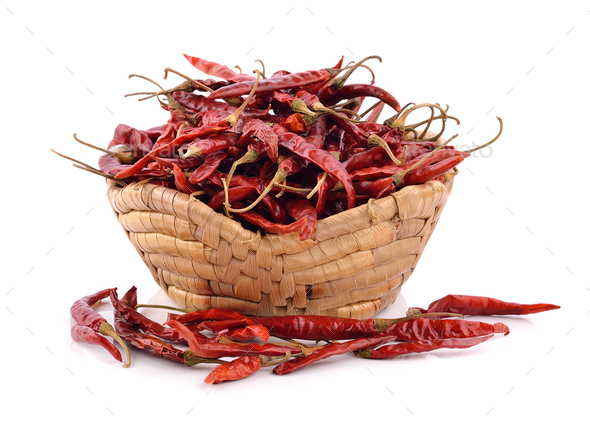 dried chili in the basket on white background - Stock Photo - Images
