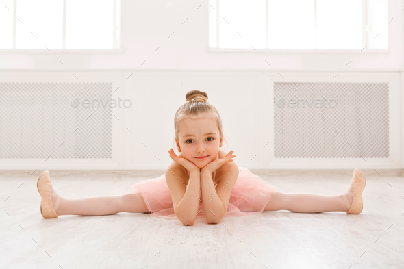 Portrait Of Little Ballerina On Floor Copy Space Stock Photo By