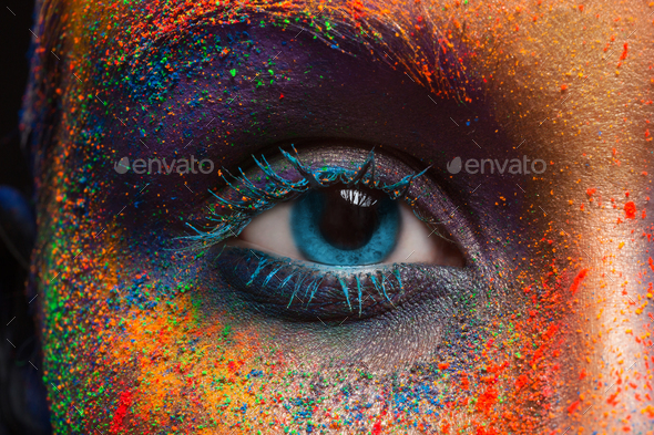 Eye of model with colorful art make-up, close-up - Stock Photo - Images