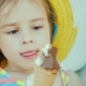 Portrait of a Cute Little Girl in a Hat. He Eats Chocolate Ice Cream. Summer Vacation with Children - VideoHive Item for Sale