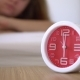 A Young and Beautiful Woman Wake Up at 6 Am By Her Red Alarm Clock at the Morning, Girl Throws Alarm - VideoHive Item for Sale
