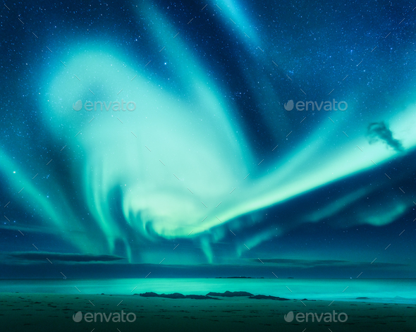 Polar lights above the sea. Green northern lights - Stock Photo - Images