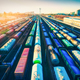 Aerial view of colorful freight trains at sunset. Cargo wagons - PhotoDune Item for Sale