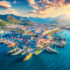 Aerial view of boats and yahts and beautiful city at sunset - PhotoDune Item for Sale