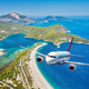 Airplane is flying over islands and sea at sunrise in summer. - PhotoDune Item for Sale