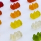 Gold Bears. Colorful Animal Gummy Candies Rows Are Moving Diagonally on the White Background. - VideoHive Item for Sale