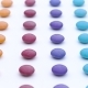 Colorful Sweet Round Candies Rows Are Moving Vertically on the White Background - VideoHive Item for Sale