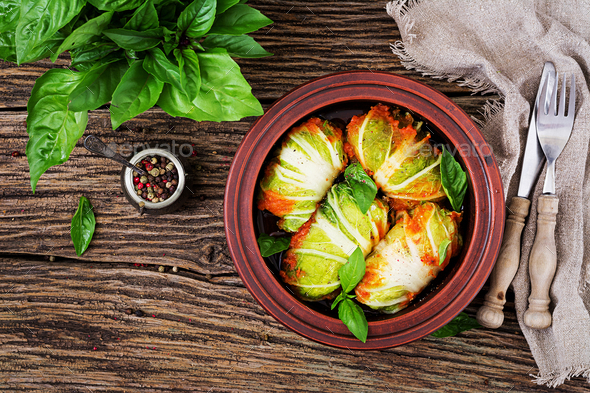 Cabbage rolls stuffed with rice with chicken fillet in tomato sauce  - Stock Photo - Images