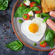 fried eggs in the shape heart, sausage, toast and caprese salad of a tomato, basil and mozzarella - PhotoDune Item for Sale