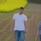 Farmers Talking While Walking On Agricultural Field - VideoHive Item for Sale