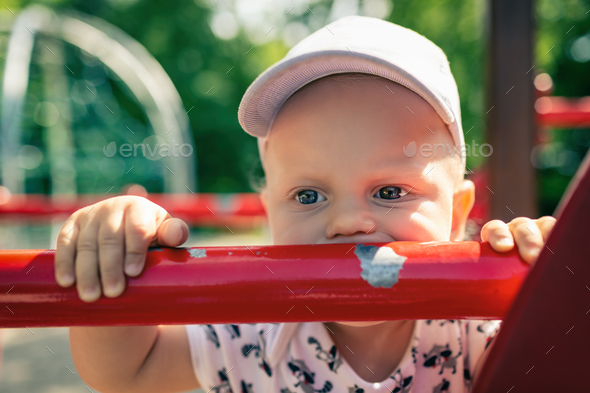 Baby boy playing in playground alone. - Stock Photo - Images