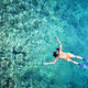 Woman snorkeling in tropical sea water - PhotoDune Item for Sale
