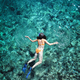 Woman snorkeling in emerald sea water - PhotoDune Item for Sale