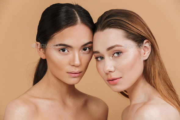 Beauty portrait closeup of two different nation women, asian and - Stock Photo - Images