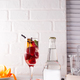 alcohol cocktail with fresh fruits and berries with a bottle of tonic and a place - PhotoDune Item for Sale