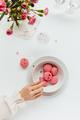Woman Taking Macaron from Bowl - PhotoDune Item for Sale