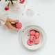 Woman's Hand Taking Strawberry Macaron from White Bowl - PhotoDune Item for Sale