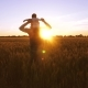 Dad Carries a Small Baby on His Shoulders Against the Background of a Golden Sunset in a Field - VideoHive Item for Sale