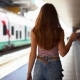Woman Traveler at the Station Goes To the Platform on the Background of a High-speed Train Going - VideoHive Item for Sale