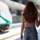 Woman Traveler Walking at Train Station - VideoHive Item for Sale