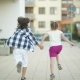 Two Happy Children Run Together Holding Hands - VideoHive Item for Sale