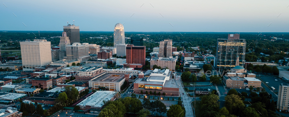 Aerial View as Night Falls on the Downtown City Skyline at Winston Salem - Stock Photo - Images