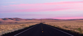 Flat Two Lane Blacktop Highway Heads into the Pink Sunset - PhotoDune Item for Sale