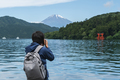 Young traveler takeing photo of  Hakone shrine with mt.Fuji at  lake Ashi, Japan - PhotoDune Item for Sale