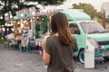Young asian woman walking in the food truck market - PhotoDune Item for Sale