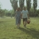 Carefree Pregnant Couple Walking in Park at Sunset - VideoHive Item for Sale