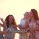 Women Laughing Together on Beach Sunset. Laughing People Traveling - VideoHive Item for Sale