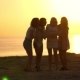 Four Tourists with Map at Beach Sunset. Summer Woman Speaking on Sea Sunset - VideoHive Item for Sale