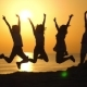 Jumping Woman Silhouette at Sea Sunset. Four Young Women Jumping in - VideoHive Item for Sale