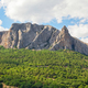 Mountain towering over a valley covered with forests at the foot - PhotoDune Item for Sale