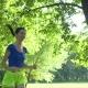 Smiling Female Runner Running in Summer Park - VideoHive Item for Sale