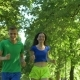 Positive Sport Runners Jogging on Park Trail - VideoHive Item for Sale