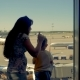 A Woman and a Boy Look at the Airport Window Waiting for a Journey - VideoHive Item for Sale