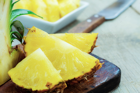 Pineapple sliced on wood - Stock Photo - Images